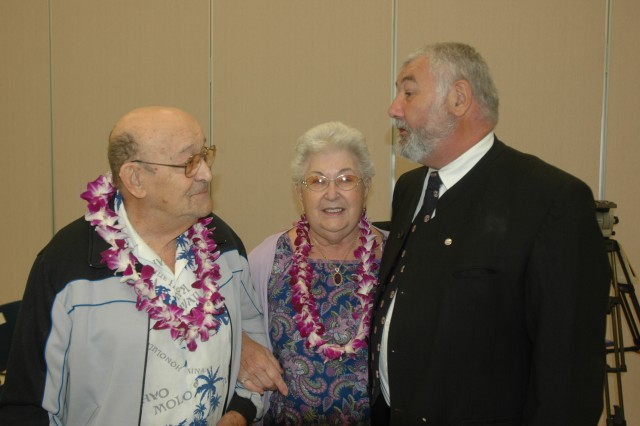 Guest speaker Pierre Moulin (left) speaks with holocaust survivors Alex and Margo Landsman after the Days of Remembrance Ceremony.