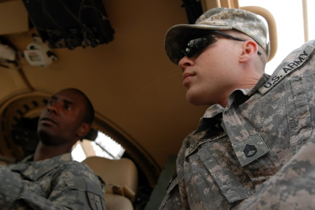 Spc. Kenneth James (left), a mechanic from Brooklyn, N.Y., and Staff Sgt. Scott Daigrepont (right), the personal security detail NCOIC both assigned to Headquarters Support Company, 46th Engineer Battalion, 225th Engineer Brigade, perform functions checks on their vehicle's gauges at Camp Liberty, April 28. Daigrepont and his other Soldiers experienced firsthand the capabilities of the MRAPs armor during an attack April 25.