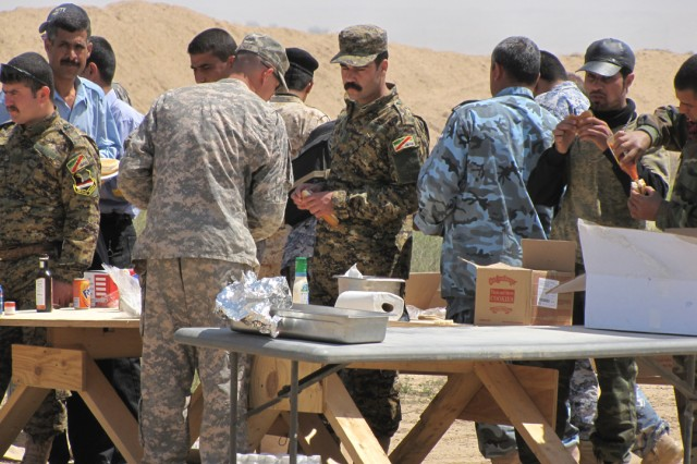 Iraqi soldiers, police and members of the U.S. Army take a break for lunch during a marksmanship competition with Coalition and Iraqi Security Forces at Forward Operating Base Bernstein, April 19. The event was sponsored by Company A, Special Troops Battalion, 3rd Infantry Brigade Combat Team, 25th Infantry Division, to strengthen relationships.
