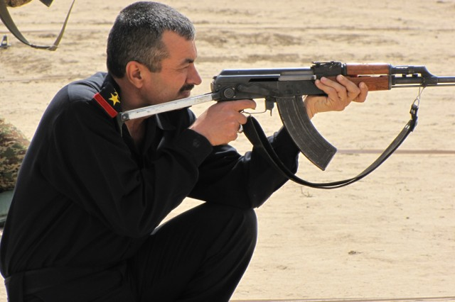 Amerli Police Chief Sabah Safar Khalif fires his AK-47 rifle during a marksmanship competition between Coalition and Iraqi Security Forces at Forward Operating Base Bernstein, April 19. The event was sponsored by Company A, Special Troops Battalion, 3rd Infantry Brigade Combat Team, 25th Infantry Division to strengthen relationships.