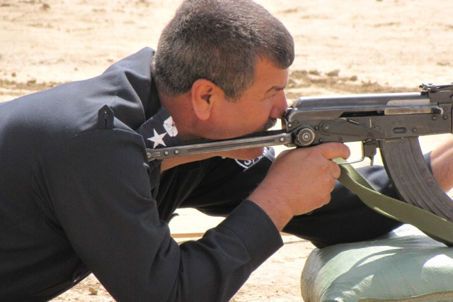Suleyman Bek Police Chief Col. Salah Mohammad Ishmael fires his AK-47 rifle during a marksmanship competition between Coalition and Iraqi Security Forces at Forward Operating Base Bernstein, April 19. The event was sponsored by Company A, Special Troops Battalion, 3rd Infantry Brigade Combat Team, 25th Infantry Division, to strengthen relationships that will last long after Coalition Forces depart Iraq in 2011.