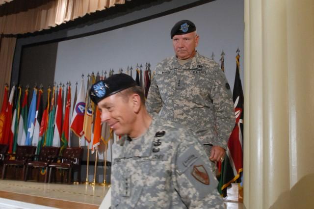 Lt. Gen. William G. Webster, U.S. Army Central commanding general, follows Gen. David Petraeus, U.S. Central Command commanding general, off the stage, after taking command of U.S. Army Central at Fort McPherson, Ga., May 4.