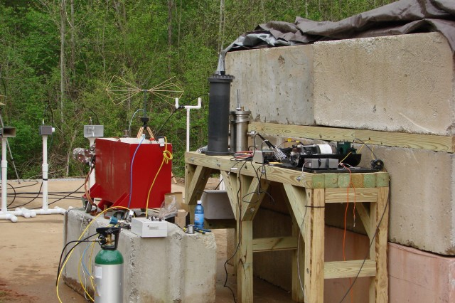 The Marx generator (in red box) is used to drive the high-power microwave source (standing silver container on the table) to make sure the high power microwave tube was not damaged in transit from Texas Tech. University to Redstone Arsenal.