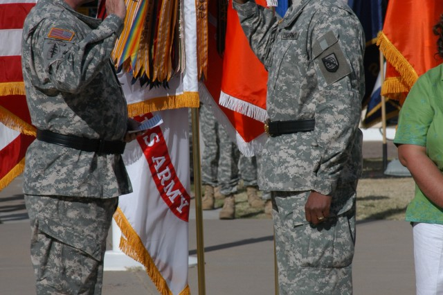 Gen. Charles Campbell (left), commanding general, U.S. Army Forces Command, delivers the Oath of Allegiance to newly promoted Brig. Gen. LaWarren Patterson, deputy commanding general, Network Enterprise Technology Command/9th Signal Command (Army), at Patterson's promotion ceremony April 24.""