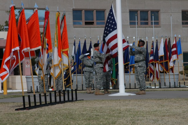 Senior noncommissioned officers of the Network Enterprise Technology Command/9th Signal Command (Army) take charge of the colors April 24, during Retreat.  It was the culminating event of the promotion ceremony of Brig. Gen. LaWarren Patterson, deputy commanding general, NETCOM/9th SC (A).