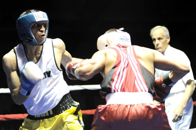 All-Army boxer Sgt. Reyes Marquez (left) of Fort Myer, Va., wins a silver medal in the 152-pound division of the 2009 Armed Forces Boxing Championships after dropping a 30-29 tiebreaker to Staff Sgt. Joshua Gomez of Kirtland Air Force Base, N.M., on May 1 at Barnes Field House on Fort Huachuca, Ariz.