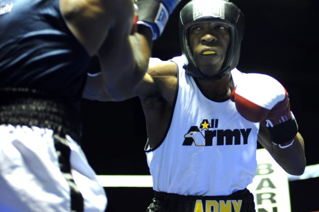 All-Army boxer Pfc. Sidney Williams, a Reservist from Kentucky, delivers a right jab to the head of Navy SK Abdullah Johnson en route to a 19-17 victory in the 165-pound division of the 2009 Armed Forces Boxing Championships May 1 at Barnes Field House on Fort Huachuca, Ariz.