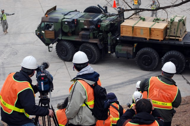 Media members shoot video of a Heavy Expanded Mobility Tactical Truck during rail load operations at Camp Carroll, South Korea as part of the second annual Key Resolve / Foal Eagle Exercise.