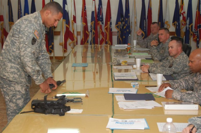 Sgt. Ahmad Mahmoud, gun truck commander, 70th Transportation Company, 391st Combat Sustainment Support Battalion, 16th Sustainment Brigade, disassembles his M16 and answers questions from a panel of command sergeants major at the 16th Sust. Bde., Warrior and Warrior Leader of the Quarter board at Contingency Operating Base Q-West, Iraq, April 22. Mahmoud defeated five of his peers to earn the Warrior Leader of the Quarter title. Mahmoud, who is Egyptian and in the process of getting American citizenship, said he came to the U.S. with his family when he was 12-years-old. He joined the Army in 2002 to travel, and is on his third deployment.