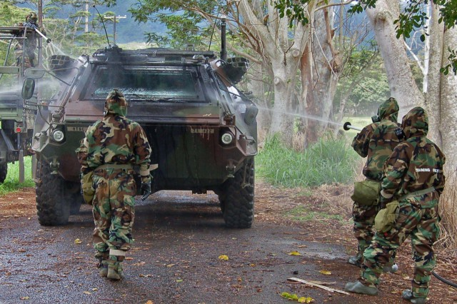 """Soldiers from the 71st Chemical Company demonstrate decontamination procedures using specialized equipment and a M903A1 Fox vehicle Tuesday, April 28.  The demonstration was conducted during a visit of members of the Singapore Army."""""""