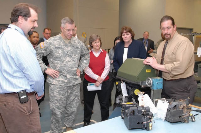 Brig. Gen. Thomas W. Spoehr, director of Integration, Office of the Deputy Chief of Staff, is briefed on the Bradley Fighting Vehicle Branch's Reset workload, during his visit to Tobyhanna Army Depot on April 16.