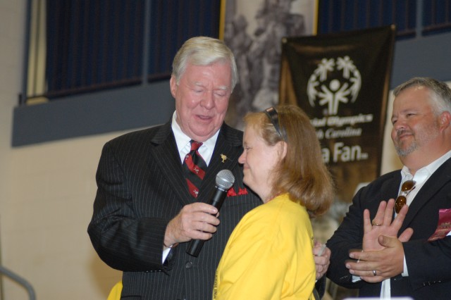 Cindy Henson, a track and field athlete, recites the athletes oath during the opening ceremony of the Special Olympics 2009 Summer Games Friday at the Solomon Center. Also pictured are TV personality Joe Pinner, left, who emceed the ceremony and Barry Coats, president of the South Carolina Special Olympics.