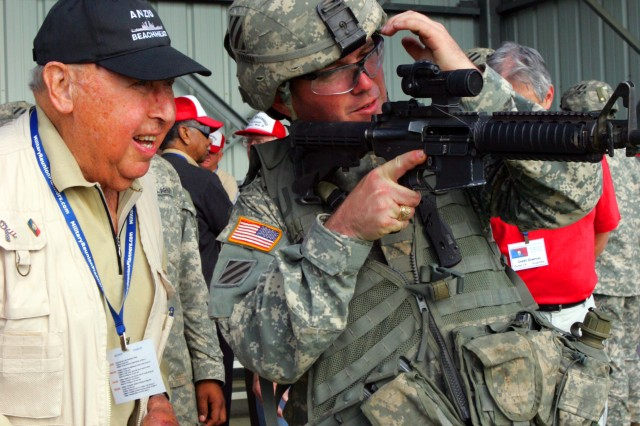 Second Lieutenant John Parsons,1/64 Armor, 2nd HBCT, 3rd ID, shows Anzio Beachhead veteran Joe Salonia some advances in sight technology and the accuracy of the modern scope.