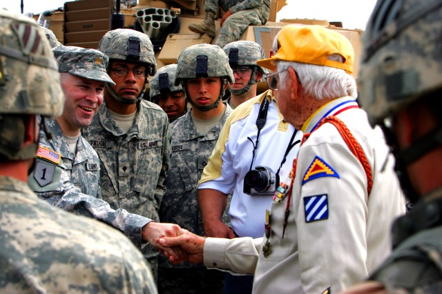 George Dexter meets Soldiers from 2nd HBCT during a reunion of World War II veterans from the battle at Anzio Beachhead at Fort Stewart's Red Cloud firing range, April 28.