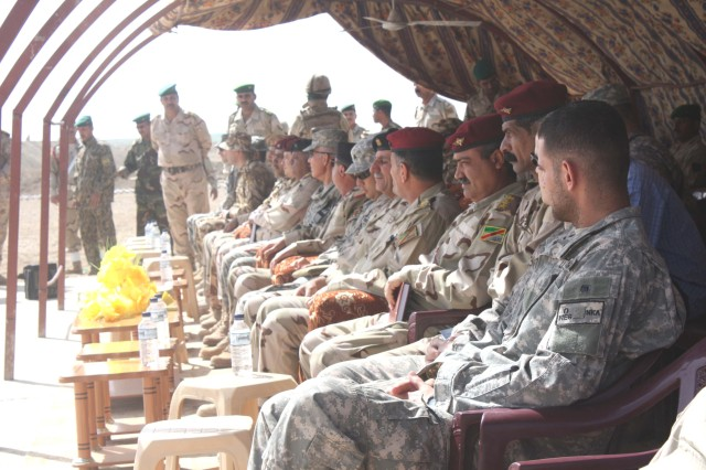Leaders from the Iraqi Army and Coalition forces watch a graduation ceremony for 65 Iraqi Soldiers of the Commando Battalion, 10th Iraqi Army Division at Camp Dhi Qar May 2.  The commandos graduated from an eight week advanced training course taught by U.S. and Romanian Special Forces.