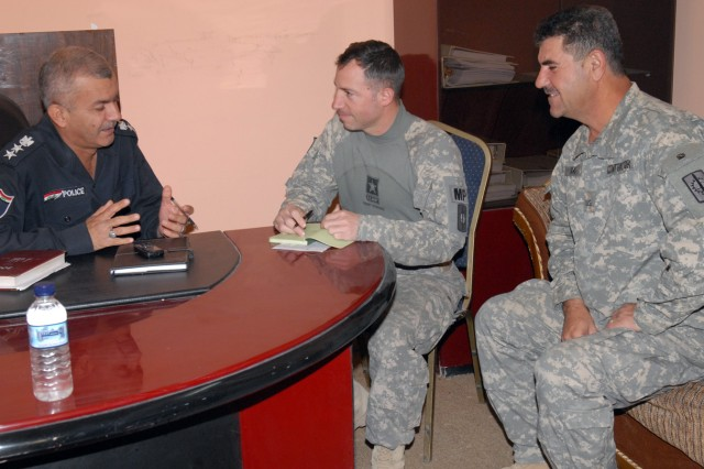 BAGHDAD - Trenton, N.J. native, Maj. Robert Arnold (center), a military policeman assigned to Headquarters and Headquarters Company, 8th Military Police Brigade, meets with Col. Fadil Abbas Bedewe, commander of the al-Karkh Police to discuss ways to synchronize the different departments of the al-Karkh police force May 6.