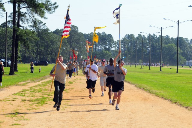 Soldiers hold guidons high at the BOSS Walk for Pride event, May 2 at Donovan Field. More than 600 Soldiers and Family Members attended the Stewart-Hunter event.