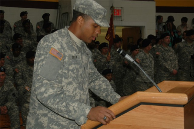 1st Lt. Jevon E. Taylor, platoon leader, 368th Trans. Co., bids the crowd and Fort Story farewell while resolutely accepting the challenge of embarking upon the 12-month deployment to Iraq.
