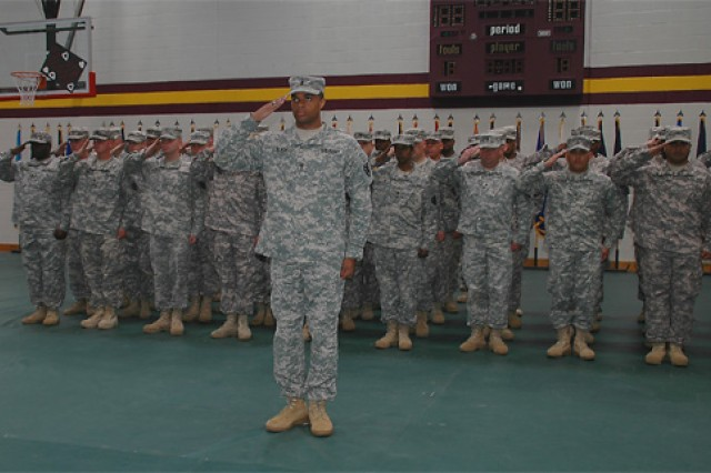 The 368th Trans. Co. renders a collective salute during the national anthem at their departure ceremony April 30 at the Fort Story Gymnasium. They will be deploying to Iraq for 12 months where they will manage containers for convoys throughout Iraq.