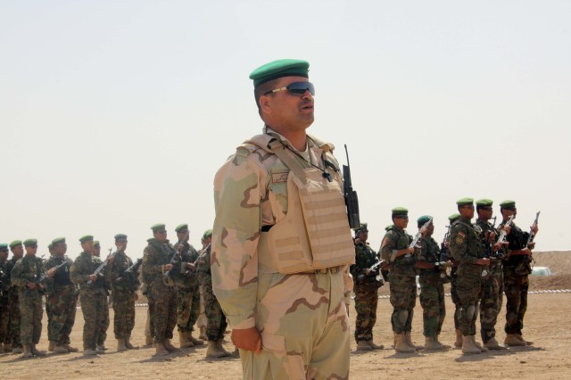 An Iraqi officer from the Commando Battalion, 10th Iraqi Army Division stands in front of his Soldiers during their graduation ceremony at Camp Dhi Qar May 2.  The Soldiers trained for eight weeks with the U.S. and Romanian Special Forces.