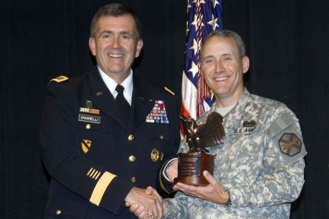 General Peter W. Chiarelli, Vice Chief of Staff of the Army presented the 3rd place award to Col. Rick Schwartz, Fort Knox garrison commander at the ACOE award ceremonies Tuesday at the Pentagon.