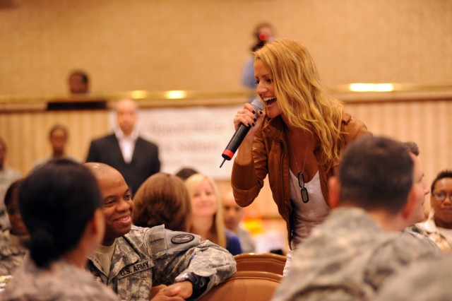 Recording artist Leigh Jones performs for a group of Warrior Transition Unit and Better Opportunities for Single Soldiers troops during an Army Family and Morale, Welfare and Recreation-backed mini-concert and meet and greet, May 6, at the Fort Belvoir Community Club.