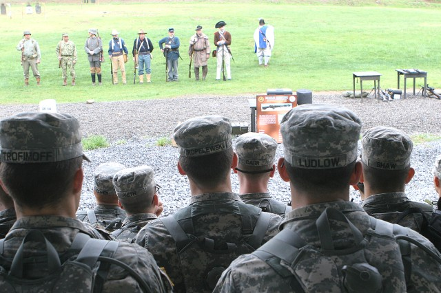 Cadets watch a demonstration about American weapons from the Revolutionary War through World War II as part of the historic weapons shoot May 2.  The shoot offered cadets an opportunity to learn about and fire weapons used by American servicemembers and enemy fighters.