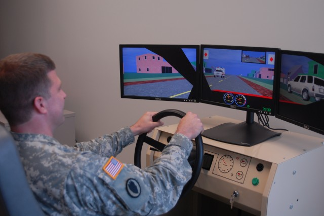 Maj. Kenneth Ford tested the driving simulator following the TBI clinic's ribbon-cutting ceremony Friday.