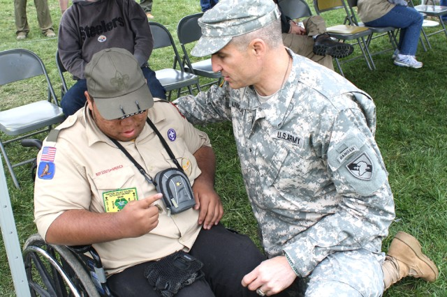 Brigadier Gen. Michael Linnington trades brass with a speical needs scout from Dutchess County. One campsite at the camporee is set up to support scouts with special needs.