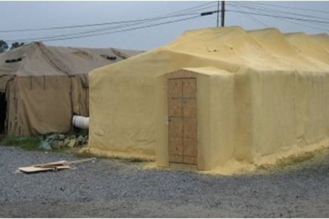 Example of Closed-Cell Spray Polyurethane Foam insulation.  The tent on the right has been sprayed with foam insulation, while the tent on the left has not.