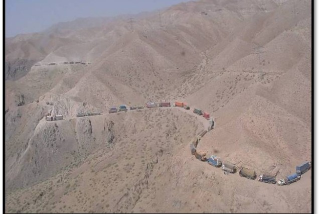 A supply convoy snakes its way through the mountains of Afghanistan.  The danger faced by the Soldiers and civilians driving and guarding these convoys stresses the need for fuel saving technologies like foam insulation.