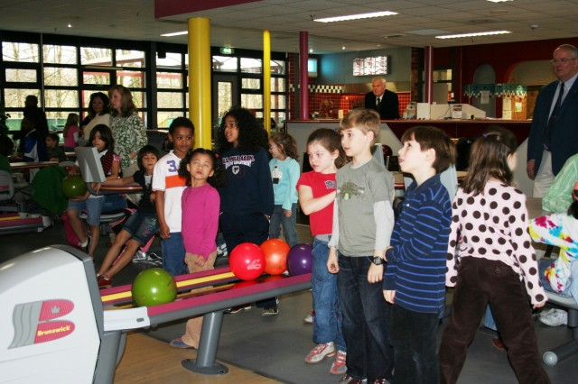 USAG Schinnen's Army Community Service, NATO's JFC Brunssum's Morale Welfare Branch and Geilenkirchen's Family Readienss Group work in concert to support the tri-border international community. Here, the Memory Lanes Bowling Center hosts children  from the tri-border region during a Month of the Military Child recognition event.