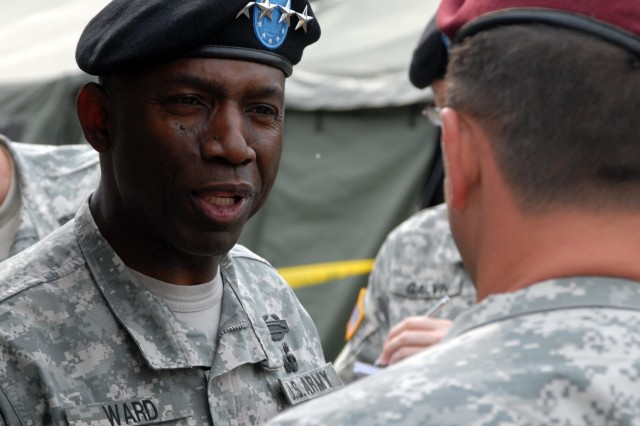"""Gen. William """"Kip"""" Ward, the commander of U.S. Africa Command, speaks with a U.S. Army Soldier during his visit to U.S. Army Africa."""
