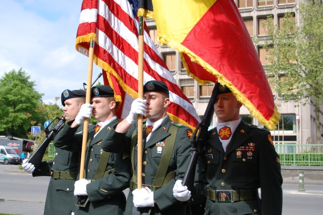 Spec. Jonathan Edwards, Sgt. Timothy Strick, Sgt. Michael Lynch and Spec. Lance LeBlanc carry the U.S. and Belgian colors in a Victory in Europe Day ceremony in Mons, Belgium, on May 8, 2009.