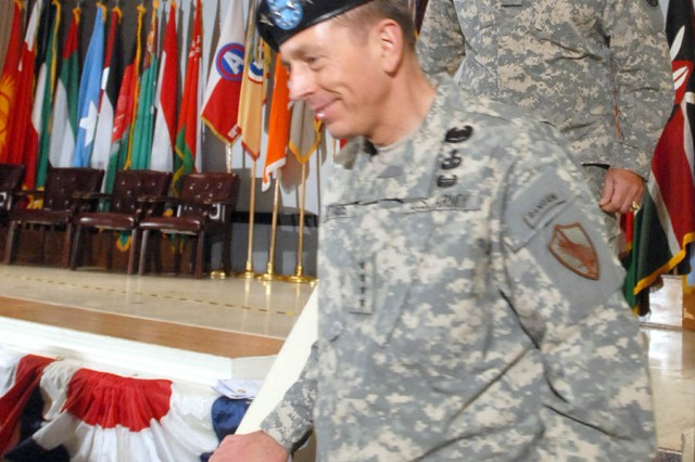 Lt. Gen. William G. Webster, U.S. Army Central (USARCENT) commanding general, follows Gen. David Petraeus, U.S. Central Command commanding general, off the stage after Webster took command of USARCENT May 4 at the Fort McPherson Post Theater.