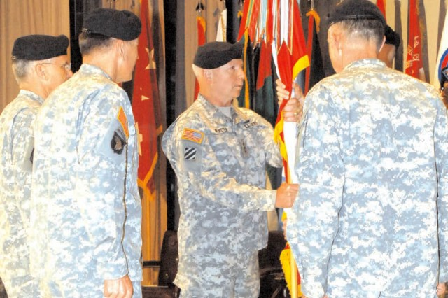 Lt. Gen. William G. Webster, U.S. Army Central (USARCENT) commanding general, passes the colors to Command Sgt. Maj. John Fourhman, USARCENT command sergeant major, at a change of command ceremony held May 4 at the Fort McPherson Post Theater. Webster comes to USARCENT after serving as the deputy commander of U.S. Northern Command and vice commander of the U.S. Element of the North American Aerospace Defense Command (NORAD), headquartered at Peterson Air Force Base in Colorado.