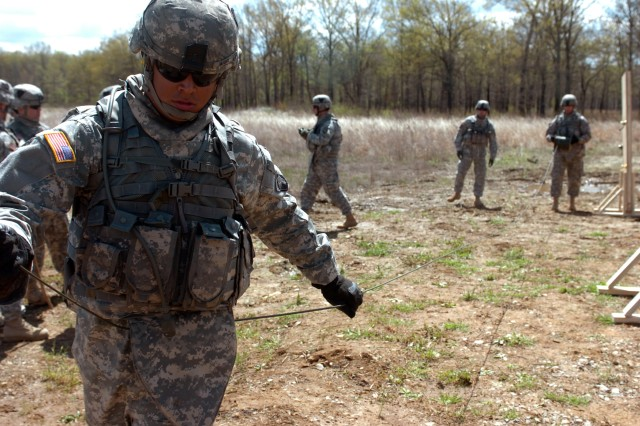 An engineer with Company A, 2nd Brigade Special Troops Battalion, 2nd Brigade Combat Team, 101st Airborne Division (Air Assault), spools out a line while prepping an initiating system during demolitions training April 21.