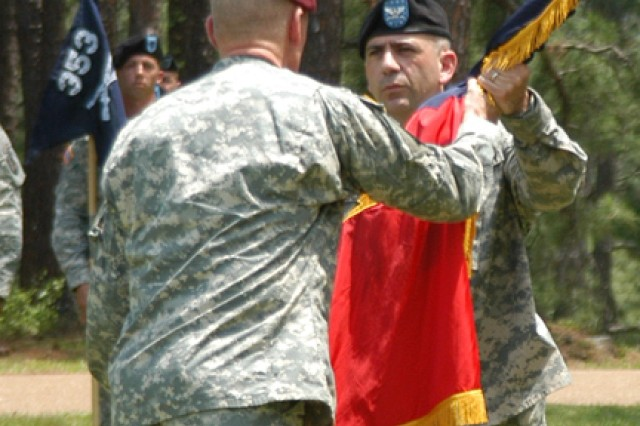 Brig. Gen. James Yarbrough gives the colors and command of the 162nd Infantry Brigade to Col. Mark Bertolini during the unit's reactivation ceremony and change of command May 1 at Warrior Field. Bertolini replaces former commander Col. Richard Bloss.