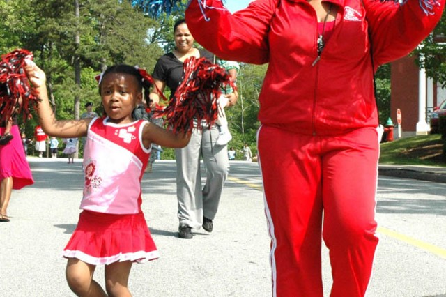 Maya Jackson, 4, cheers along with her mother, Jeanine. Maya's father is retired Sgt. 1st Class Joe Lane, who curworks with the Atlanta Public School system Reserve Officer Training Course.