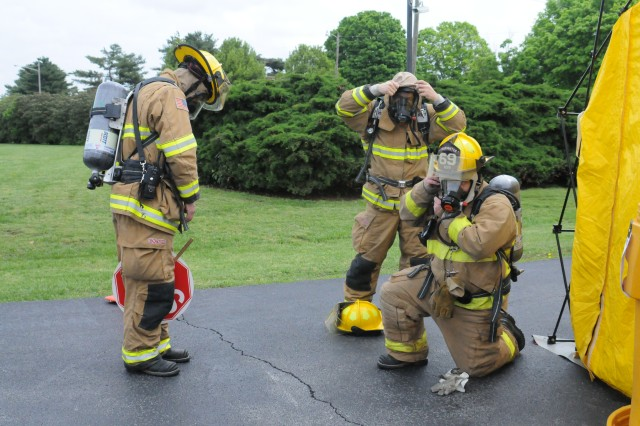 Fort Campbell firefighters prepare to enter the Garrison Headquarters to search for a suspicious package as part of a scenario Wednesday to test the installation's abilities to respond to such a crisis.