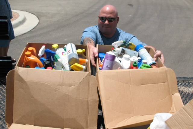 Staff Sgt. Michael Moore, of the 4th Infantry Division, Fort Hood, Texas, disposes of two boxes full of hazardous household products during a household hazardous and bulk recyclable material turn-in event at two of the housing community centers on Fort Hood. The event was sponsored by  the Fort Hood Environmental Division, Fort Hood Recycle, and Fort Hood Family Housing.