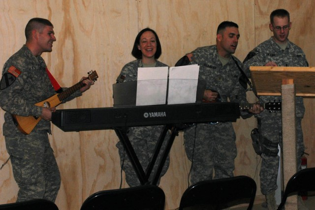 "BAGHDAD - ""The Never-Ending Band"" lead a song for the congregation, made up of military service members who gathered together to celebrate and participate in the National Day of Prayer on Joint Security Station War Eagle, north of Baghdad, May 7.  Soldiers from the 1st ""Ironhorse"" Brigade Combat Team, 1st Cavalry Division came together and prayed collectively for all service members and their loved ones."