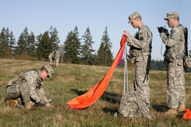 Soldiers set up marking panels during a GMRS drop April 21.