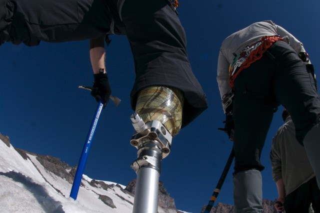 Chad Jukes, a former Soldier, walks through the snow on his prosthesis during training at base camp during the 2008 Camp Patriot ascent of Mount Rainier.
