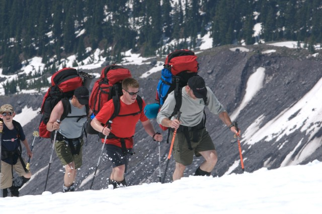 Guide Curtis Fawley leads Ryan Job (red shirt) toward the snow fields on Mount Rainier in 2008. Following Job are Camp Patriot founder Micah Clark and Fawley's son, Keagan Fawley.