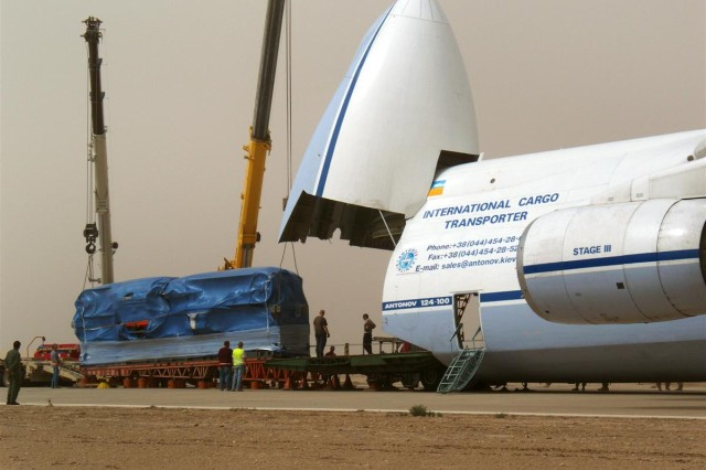 Equipment parts for the new water bottling plant took a major step forward when the delivery of plastics Blow Injection Molder aboard the world's second largest aircraft, an Antonov An-124 airplane arrived at Contingency Operating Base Adder, Iraq, March 23