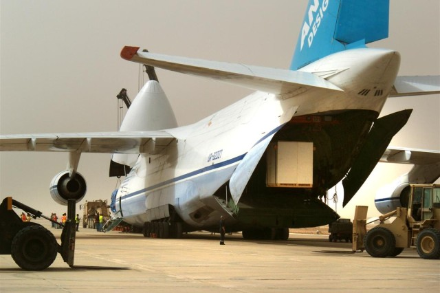 """It takes a big plane to deliver a """"portable"""" water bottling plant. An Antonov An-124, the world's second largest aircraft with a payload of 150 tons, was used to deliver the plant's main equipment from Camp Taqqadum to Contingency Operating Base Adder, March 23"""