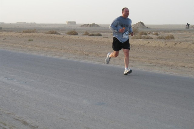 "Sgt. 1st Class Chris Baker, 287th Sustainment Brigade postal noncommissioned officer in charge, native of Quincy, Mass. during the first leg of the Boston Athletic Association-sanctioned ""Boston Marathon in Iraq"" at Contingency Operating Base Adder, Iraq, April 18."