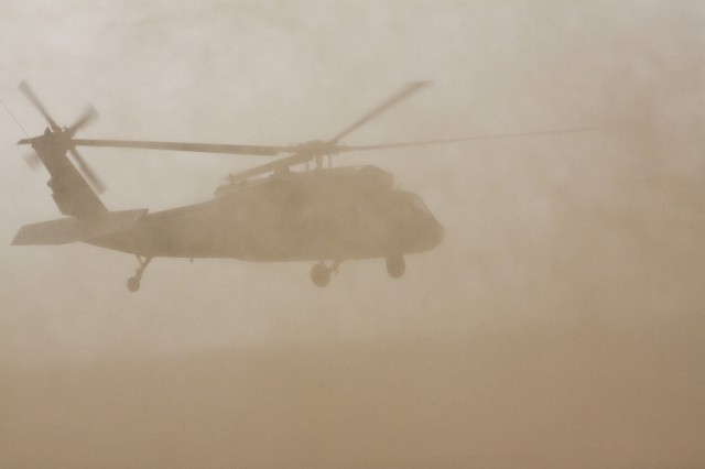 Dust fills the air and creates an almost a no visibility situation as a UH-60 Black Hawk helicopter  from 3rd Assault Helicopter Battalion, 227th Aviation Regiment, 1st Air Cavalry Brigade, 1st Cavalry Division, lifts off during dust landing qualifications, Camp Beurhing, Kuwait, May 7. Dust landings are  mandatory training for Aviators and crew chiefs of the 1st Air Cav. Bde. before they can move north and support Operation Iraqi Freedom.
