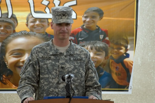 BAGHDAD -  Dearborn, Mich. native, Col. Joseph Martin, commander, 2nd Heavy Brigade Combat Team, 1st Infantry Division, Multi-National Division-Baghdad, speaks of the improvements in security as an important factor in the completion ceremony of the new Abu Ghraib Civil Defense Directorate May 7 in Abu Ghraib. The new facility is one of many civil capacity projects in the Abu Ghraib.